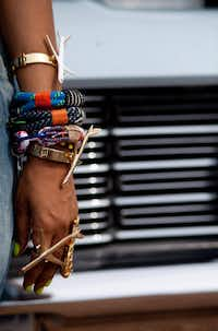"Badu's jewelry includes ""I'm Fly"" bracelets and ring crafted by friend and designer Melody Ehsani."