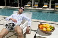 Thom Browne striped rugby, $310, Barneys New York; Balmain swim trunks, $625, Forty Five Ten; silver aviator sunglasses, $14, Urban Outfitters.(Steve Wrubel)