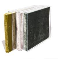 Velvet Raptor velvet photo albums with acrylic slipcases, $285 each, Nest