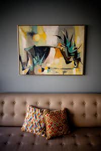 A prized Otis Dozier painting above the living room sofa.