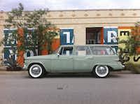 Baker's 1960s Studebaker Lark parked in front of his office