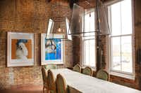Janet Healey and Joe Grisham's dining room includes custom fixtures and a cabinet previously used for display in a Snider Plaza antiques store.