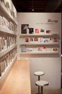 The first-floor entry serves double duty as greeting card shop and gallery for framed photos.