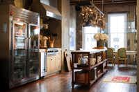Designer Shannon Bowers contributed to the kitchen renovation; the island is a marble- topped 18th-century draper's table.