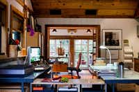 """Illustrator Narda Lebo's office, in a renovated garage behind her Kessler Park home. """"I love not commuting. It doesn't seem like it's a bother that I don't separate home and work, I actually enjoy it,"""" she says."""