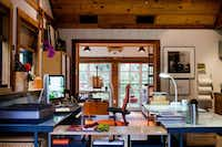 "Illustrator Narda Lebo's office, in a renovated garage behind her Kessler Park home. ""I love not commuting. It doesn't seem like it's a bother that I don't separate home and work, I actually enjoy it,"" she says."