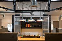 """Matchbox's production table, the """"heart of the office."""""""