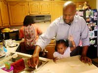 Jamal Sterling makes beignets with his daughter India, 3, and his wife Nicole Sterling (in background) at their Plano, Texas home, Wednesday, Sept. 3, 2014. Sterling is an actor who will be starring in Thinner Than Water at Kitchen Dog Theate.(Anja Schlein - Special Contributor)