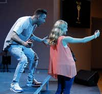 "Lauren Stolle, 16 of East Bernard, TX takes a selfie with Landon Pickering, student pastor at River Pointe Church  before the start of ""The Take,"" a youth gathering event at River Pointe Church in Richmond, Texas on Wednesday, March 2, 2016. The weekly youth event brings in 800 youth to the church. (Vernon Bryant/The Dallas Morning News)(Vernon Bryant - Staff Photographer)"
