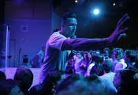 "Landon Pickering, student pastor at River Pointe Church works on making some room in the front near the stage during ""The Take,"" a youth gathering event at River Pointe Church in Richmond, Texas on Wednesday, March 2, 2016. The weekly youth event brings in 800 youth to the church. (Vernon Bryant/The Dallas Morning News)(Vernon Bryant - Staff Photographer)"