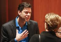 """Composer Pierre Jalbert mingled with the audience Sunday after Voices of Change performed """"Street Antiphons"""" at Caruth Auditorium.( Ron Baselice  -  Staff Photographer )"""