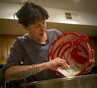 Katherine Clapner scrapes dough from a mixing bowl as she makes kolaches at her home Friday, February 5, 2016 in Dallas.(G.J. McCarthy - Staff Photographer)
