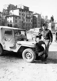 Monuments Officer Lt. Frederick  Hartt, with to his jeep, Lucky 13, was often the first to arrive on the scene after the bombs and shells had done their worst.