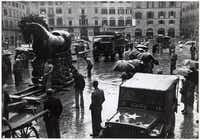 """From """"Saving Italy"""" by Robert Edsel: """"On February 16, 1945, Fred Hartt, standing next to Lucky 13, watched as Deane Keller and local workers maneuvered the statue of Cosmo di Medici and his horse, by Giambologna, back into position in the Piazza della Signoria of Florence."""""""