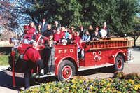 A holiday photo from 2001 of the O'Neill children and grandchildren in front of the O'Neill's' original firetruck, first used in 2001.