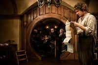 "FILE - This publicity film image released by Warner Bros., shows Martin Freeman as Bilbo Baggins in a scene from the fantasy adventure ""The Hobbit: An Unexpected Journey."" Photo/Warner Bros., James Fisher, File)"