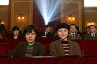 """In this image released by Paramount Pictures, Asa Butterfield portrays Hugo Cabret, left, and Chloë Grace Moretz portrays Isabelle in a scene from """"Hugo."""" (AP Photo/Paramount Pictures, Jaap Buitendijk)"""