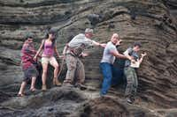 "In this image released by Warner Bros. Pictures, from left, Luis Guzman, Vanessa Hudgens, Michael Caine, Dwayne Johnson and Josh Hutcherson are shown in a scene from ""Journey 2: The Mysterious Island."""