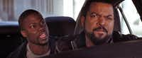 "This image released by Universal Pictures shows Ice Cube, right, and Kevin Hart in a scene from ""Ride Along."""