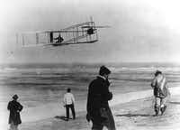 In this undated file photo, Orville and Wilbur Wright test their airplane on a beach. The Wright brothers have long been credited as the first to achieve powered flight. But in June, 2013, Connecticut Gov. Dannel P. Malloy signed a law giving German-born aviator and Connecticut resident Gustave Whitehead the honor of being first. On Thursday, Oct. 23, 1013 Ohio state Rep. Rick Perales and North Carolina state Sen. Bill Cook held news conferences to dispute Connecticut's action and reassert the Wright Brothers were first in flight. (AP Photo/File)