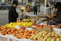 The farmers market brings color to an already lively street scene.( Eric Risberg  -  AP )