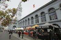 Load up  on produce  at the Ferry Plaza Farmers Market, which is held Tuesday, Thursday and Saturday.(Photos by Eric Risberg - The Associated Press)