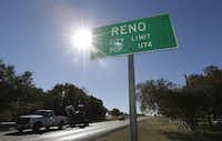 In this Wednesday, Nov. 19, 2014 photo, vehicles drive past the city limits of Reno, Texas. This rural community sits surrounded by hydraulic fracturing drilling operations and is considering passing a municipal ban on fracking within the city limits. (AP Photo/LM Otero)(LM Otero - AP)