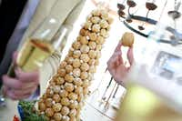 Sugar high: Trade the fondant-covered cake for croque-en-bouche, the traditional gâteau served at French weddings. This towering sweet, from Tart Bakery (5219 W. Lovers Lane, Dallas, 469-335-8919, tartbakerydallas.com), is an ascending pyramid of cream puffs glued together with spun sugar. The inside of each puff is traditionally filled with dreamy crème patisserie or crème chantilly.