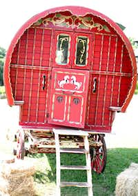 A getaway car most clever. The Gypsy wagon — a fresh alternative to a vintage Rolls-Royce — is an original from Holland, circa 1850. The wagon is available for rental through De Ridder Antiques in Forney (972-564-4468, deridderantiques.com).