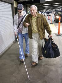 In this photo released by Brigham and Women's Hospital, Dallas Wiens (left) arrives with his grandfather Del Peterson at Logan International Airport, en route to Brigham and Women's Hospital in Boston for a full face transplant during the week of March 14, 2011.