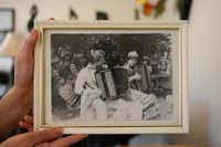 Elena Fainshtein holds a photo of her and her husband, Gregory, playing together in what is now Belarus in 1981.Rose Baca - neighborsgo staff photographer