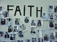 "A board with ""Faith"" spelled out in black electrical tape near New York's Union Square on Sept. 15, 2001 is filled with photos and details of World Trade Center employees missing after the Sept. 11 attacks."