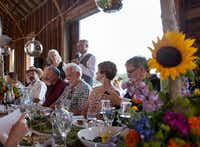 Debra Prinzing of Slow Flowers and Kasey Cronquist of Certified American Grown Flowers address the dinner guests.( California Cut Flower Commission  )