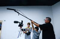Eric Jewell, production director at The Movie Institute, provides instruction to his son Jordan Jewell, 15, (left) and Jack Schulz, 13, during the institute's halloween movie workshop at Valley View Center. The nonprofit, which recently moved to its new facility at Valley View Center, provides film camps and classes to young people. The new facility includes a production stage, edit bays, production rooms and instructional screening room.