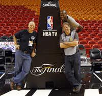 Michael, joined by staff photographers Tom Fox (right) and Vernon Bryant (above right), covered the NBA Finals in 2011.