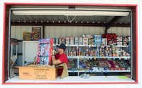 Tyler Hatch stocks Code Red combo packs at the Alamo Fireworks stand along Interstate 45 in Hutchins.