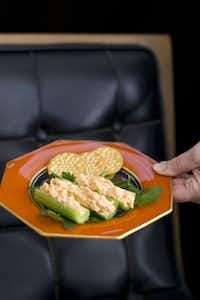 """In this image taken Feb. 13, 2012 in Concord, N.H., a recipe for stuffed celery, a grown-up twist on the old """"ants on a log"""" children's snack, is shown."""