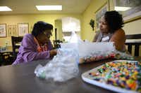 Lucretia Honore (right), activity assistant, helps Mattie Richardson sort beads at Friends Place.(Rose Baca - neighborsgo staff photographer)