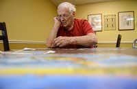 Robert Ivory works on a puzzle at Friends Place. The Alzheimer's Association estimates the number of Americans with Alzheimer's may nearly triple by 2050, barring the medical developments to prevent, slow or stop the disease.(Rose Baca - neighborsgo staff photographer)