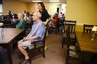 Executive director Marylynne Henry opened Friends Place's third branch after her husband Rodney (seated) suffered a brain injury that impaired his memory and ability to reason.(Rose Baca - neighborsgo staff photographer)