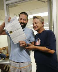 Kenny Wright, left, and Bo Bass show their marriage license to members of the media at the Oklahoma County Courthouse in Oklahoma City, Monday, Oct. 6 2014. They were the 3rd same sex couple to receive a marriage license in Oklahoma County.(AP Photo/The Oklahoman,  Steve Gooch)(Steve Gooch - AP)