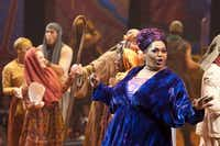 """Narrator (Liz Mikel) sings """"Jacob and Sons,"""" the story of Joseph through, during Dallas Theater Center's production of Andrew Lloyd Webber's """"Joseph and the Amazing Technicolor Dreamcoat on June 26, 2012. (Jeff Lautenberger/The Dallas Morning News)"""