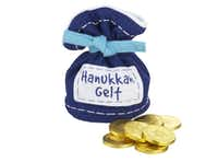 SWEET GELT: Coins of milk chocolate are wrapped in gold foil and hidden away in a blue felt bag for children to find. $12.95 at Crate & Barrel's Plano and Dallas stores and at crateandbarrel.com.