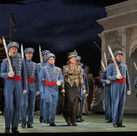 """This June 2013 photo provided by the The Santa Fe Opera shows Susan Graham during a rehearsal with the chorus in """"The Grand Duchess of Gerolstein,"""" at the Santa Fe Opera in Santa Fe, N.M."""