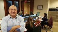 Gilbert Garcia, managing partner of Garcia Hamilton & Associates LP, in the Houston investment firm's trading room. (Gary Montgomery)