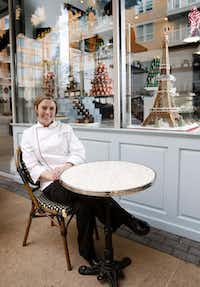 Andrea Meyer  of Bisous Bisous Pâtisserie, with a gingerbread Eiffel Tower, enjoys her family's tradition of biscuits and gravy on Christmas Day.(Rose Baca - Staff Photographer)