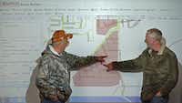 Dr. Bob Morrison, Superintendent of Garland ISD, right, and Brian Abbett, Dir. of Transportation, discuss about temporary bus routes in the tornado hit area during a meeting at the Padgett Auxiliary Services Center in Garland, Texas, Friday, Jan. 1, 2016. (Jae S. Lee/The Dallas Morning News)