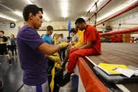 Hector Trujillo, 19, tapes up his hands before boxing practice.(Rose Baca - neighborsgo staff photographer)