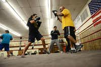 Patricia Serrano, 16, spars with volunteer coach Daryl Thomas.(Rose Baca - neighborsgo staff photographer)