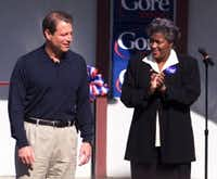 Vice President Al Gore is applauded by his campaign chairman, Donna Brazile, right, at the opening of his campaign headquarters in Nashville, Tenn., Oct. 6, 1999. (AP Photo/Mark Humphrey)